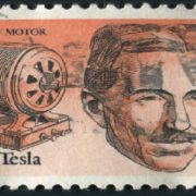 Nikola Tesla appears on a US stamp for his alternating current induction motor, which outperforms Edison's direct current.