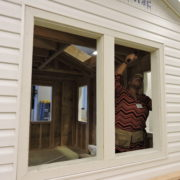 Student works on large window to improve natural light, one of today's top residential construction industry trends