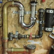 Three common plumbing tools used by a plumber