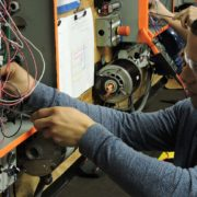 An Apex student gets hands-on, basic electrical training