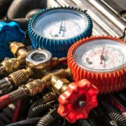 Red and blue manifold gauges on an HVAC system for small spaces