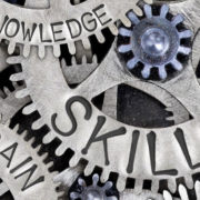 Gears with inspirational words, such as skills, knowledge and growth