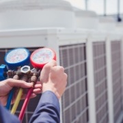 HVAC tradesperson uses AC training to check equipment