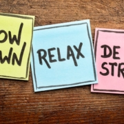 Three colorful sticky notes with tips for coping with school stress