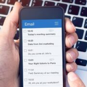 A person learns how to write a professional email