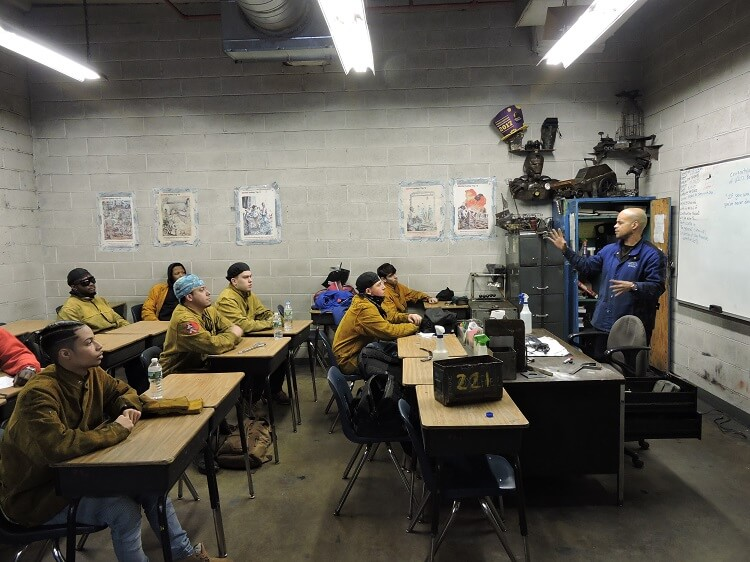 Apex students learning from an instructor