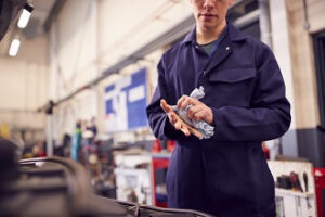 A student gets hands-on studying experience in the auto repair shop