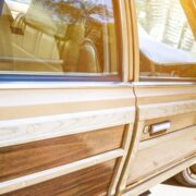 An older vehicle with wood panels needs routine car maintenance