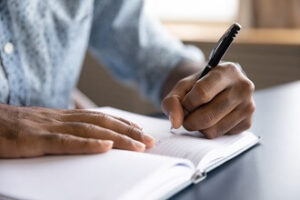 A student practices study tips and tricks by learning how to take notes