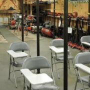 Apex Technical School plumbing classroom with desks and tools