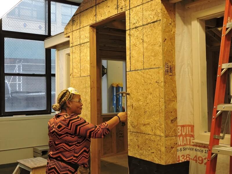 An Apex student in the Construction & Building Skills program learns to assemble walls