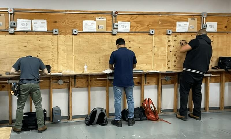 Students take night classes for Apex's Electrical program