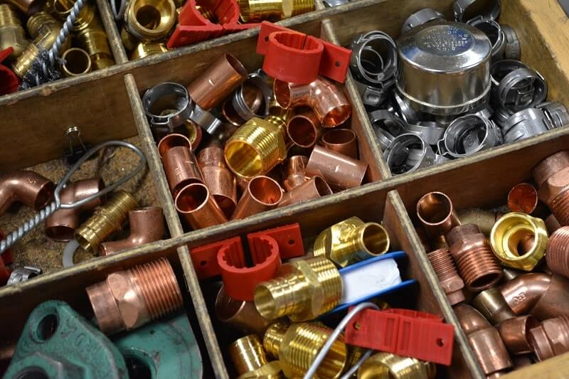 A box of different plumbing parts used in night classes at Apex Technical School